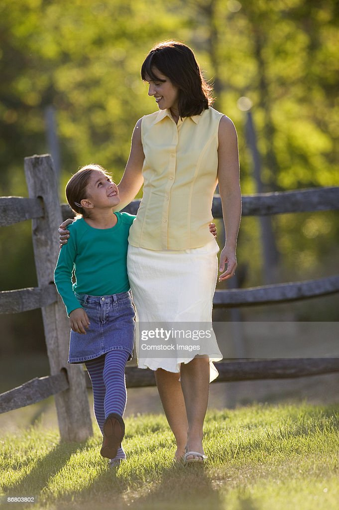 Mother and daughter walking : Stock Photo