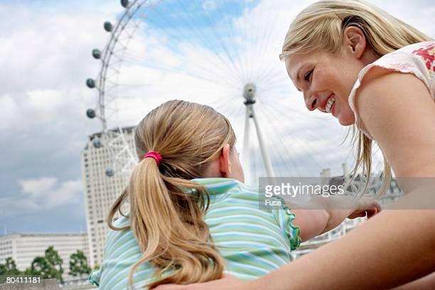 Mother and Daughter Watching London Eye