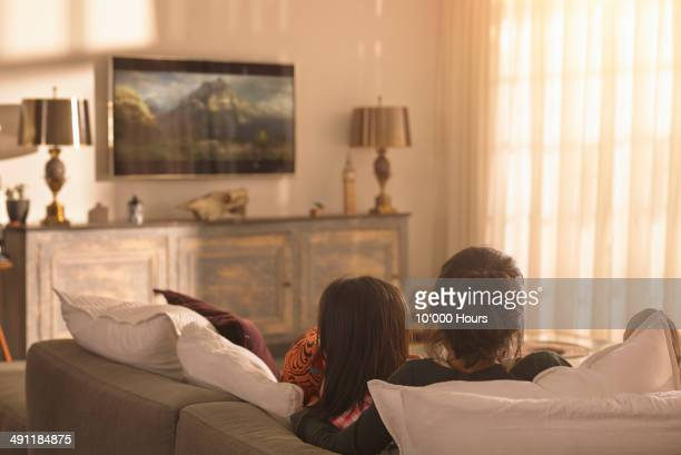 Mother and daughter watching television