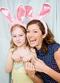 Mother and daughter wearing rabbit ears