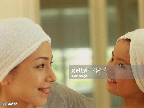 Mother and daughter wearing towel wrapped on head : Stock Photo