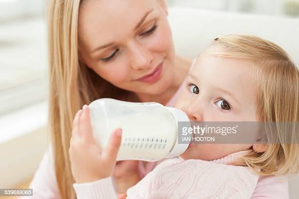 Mother and daughter with a bottle