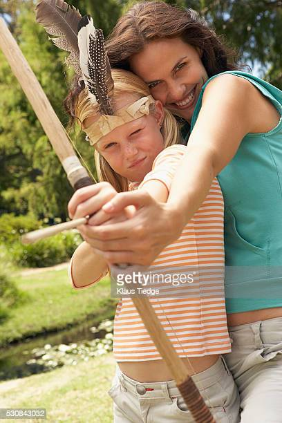 Mother and daughter with a bow and arrow