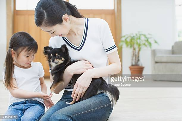 Mother and daughter with a chihuahua