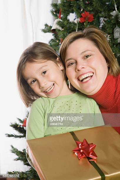 Mother and Daughter with a Christmas Present