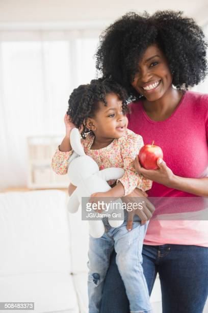 Mother and daughter with apple