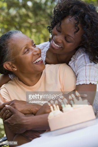 Mother and daughter with birthday cake : Stock Photo