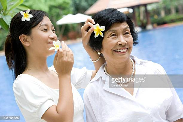 Mother and daughter with flowers in hair