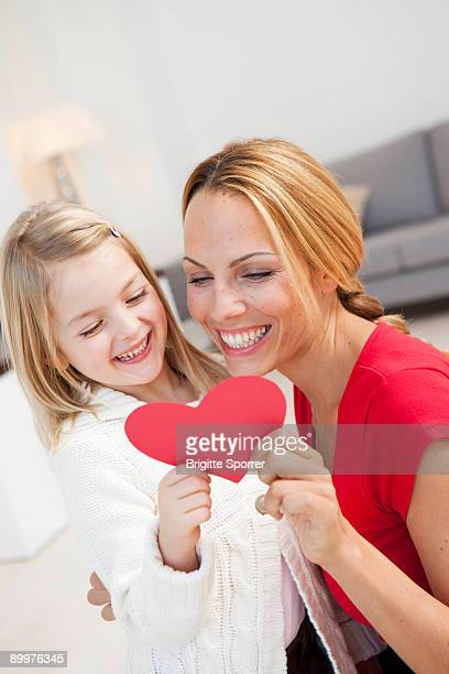 mother and daughter with heart