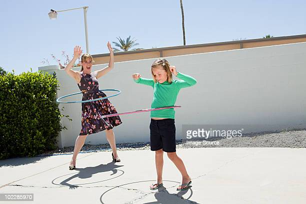 Mother and daughter with hoola hoops