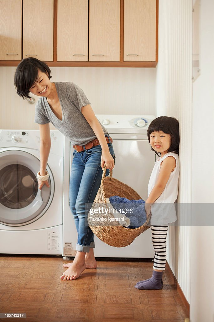 Mother and daughter with laundry basket