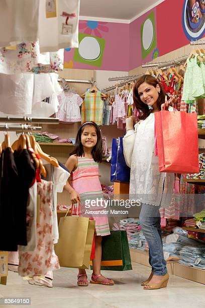 Mother and daughter with lots of shopping bags