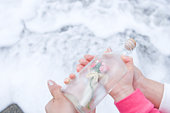 Mother and daughter with message in a bottle