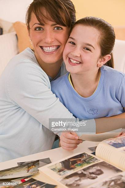 Mother and daughter with photographs