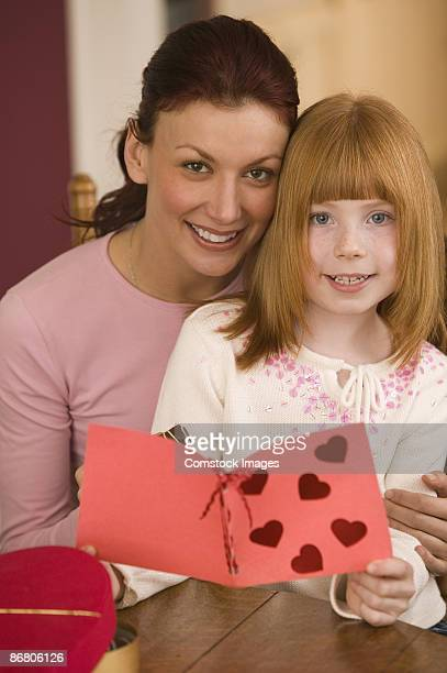 Mother and daughter with Valentine's Day card
