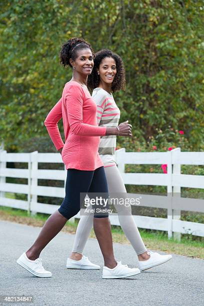 Mother and daughter working out together