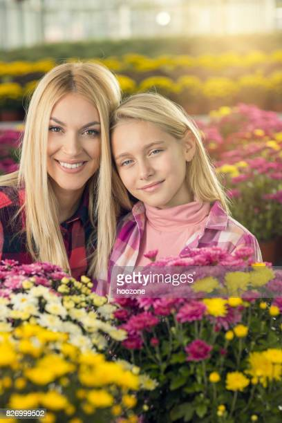 Mother And Daughter Working toghether at greenhouse