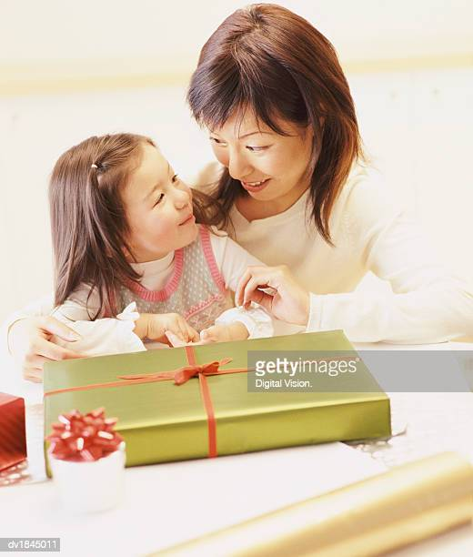 Mother and Daughter Wrapping a Christmas Present