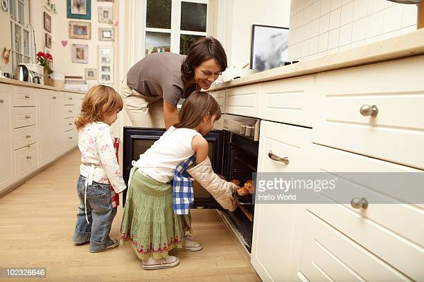 Mother and daughters baking in the kitchen