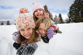 Mother and daughters in snow