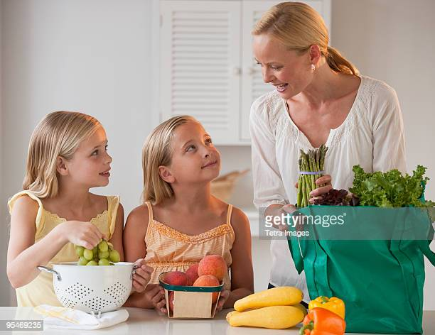 Mother and daughters in the kitchen