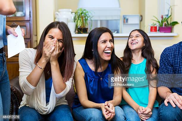 Mother and daughters laughing while spending time together