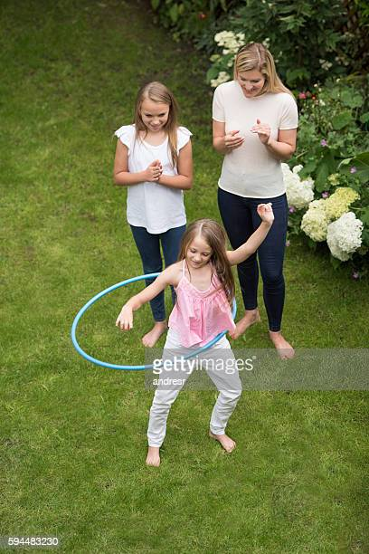 Mother and daughters playing outdoors