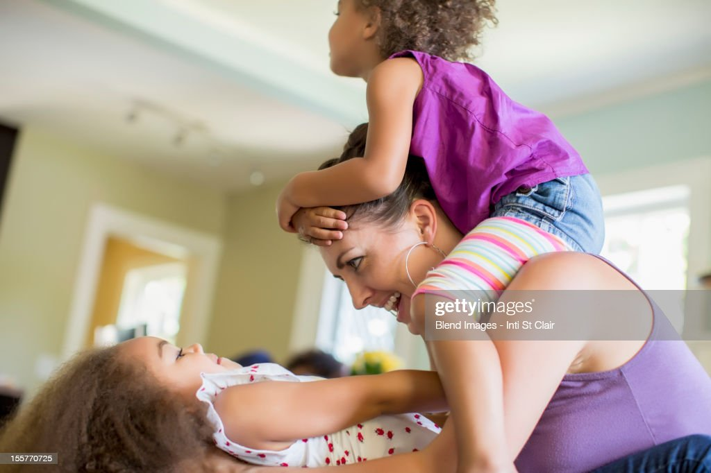 Mother and daughters playing : Stock Photo