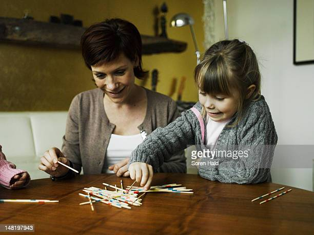 Mother and daughters playing together