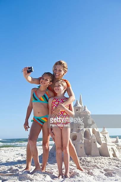 Mother and daughters taking photo