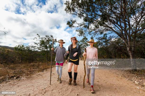 Mother and daughters walking on a trail