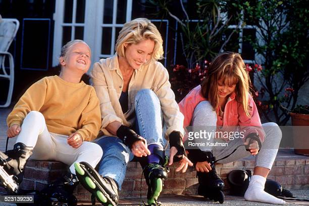 Mother and Daughters with Inline Skates