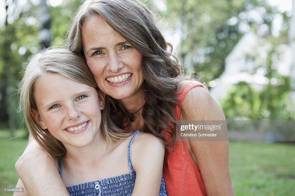 Mother and daugther in garden : Stock Photo