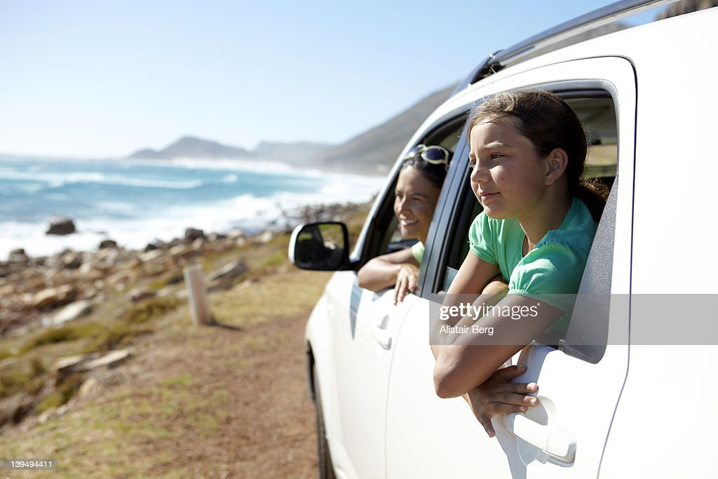 Mother and daugther looking out of car : Stock Photo