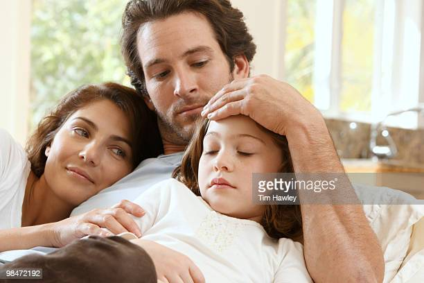 Mother and Father at home with sick daughter