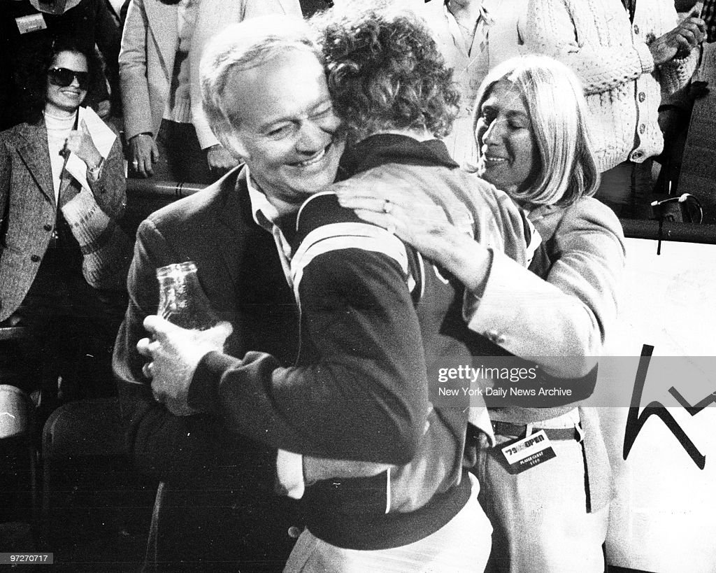 Mother and father congratulate John McEnroe after winning U