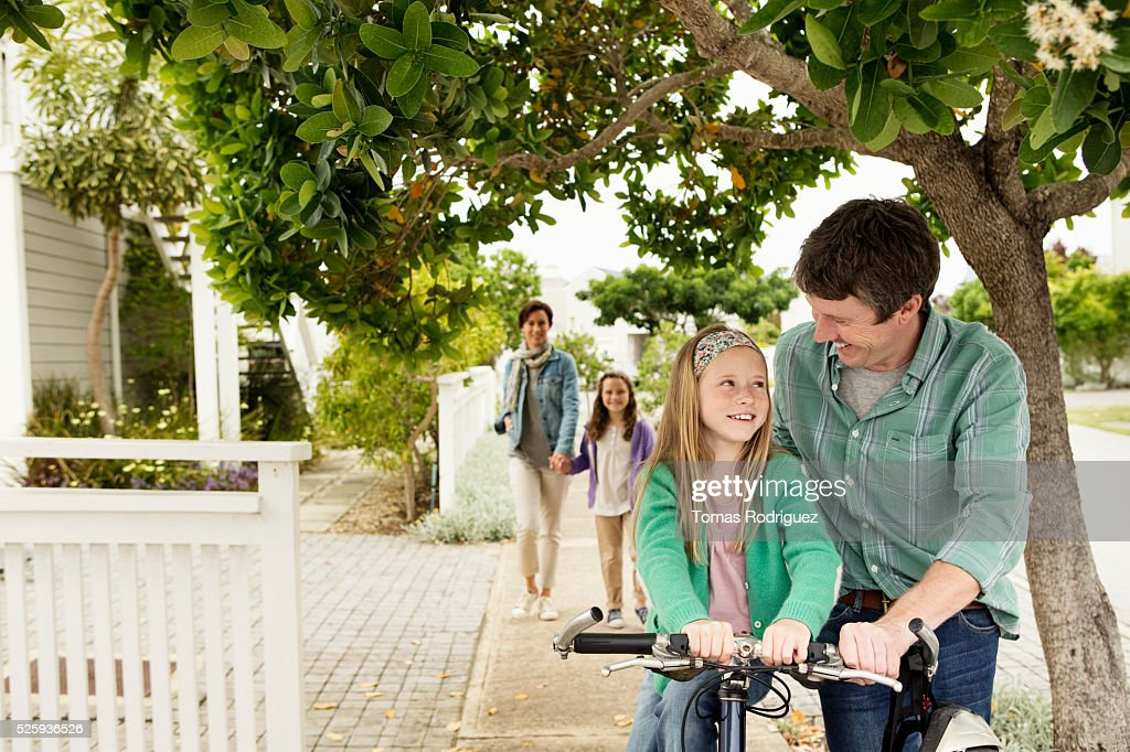 Mother and father during walk with two girls (6-7), (8-9) : Stock Photo