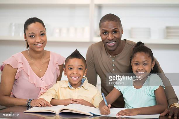 Mother and Father Homeschooling Their Children