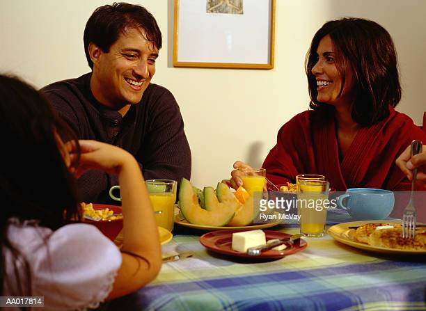 Mother and Father Laughing at the Breakfast Table