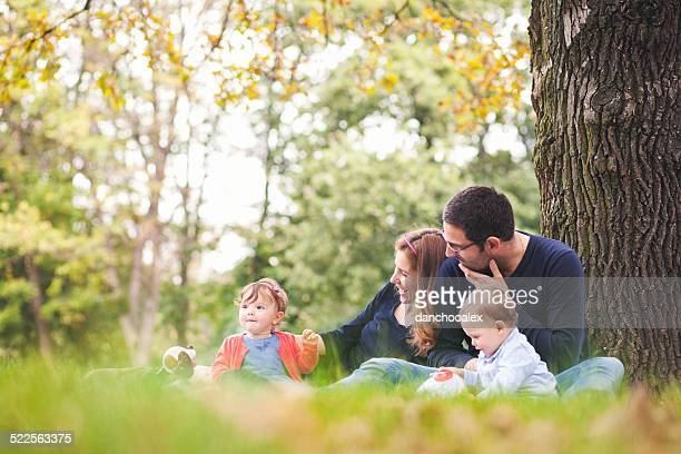 Mother and father outdoors in the park with their kids