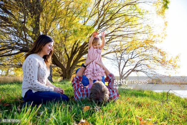 Mother and Father playing with toddler girl