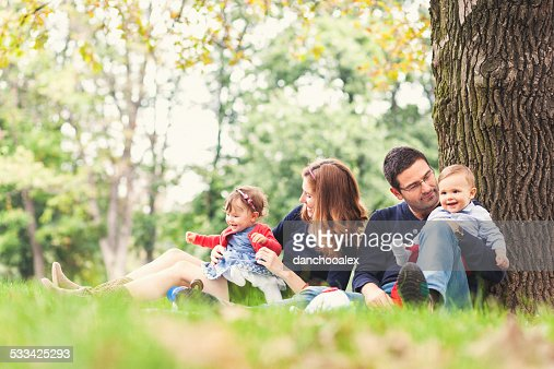 Mother and father with their babies outdoor