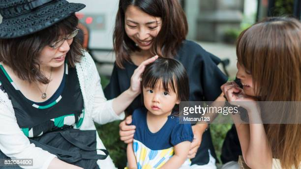 Mother and friends chatting around a baby