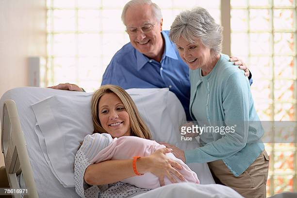 Mother and Grandparents with Newborn