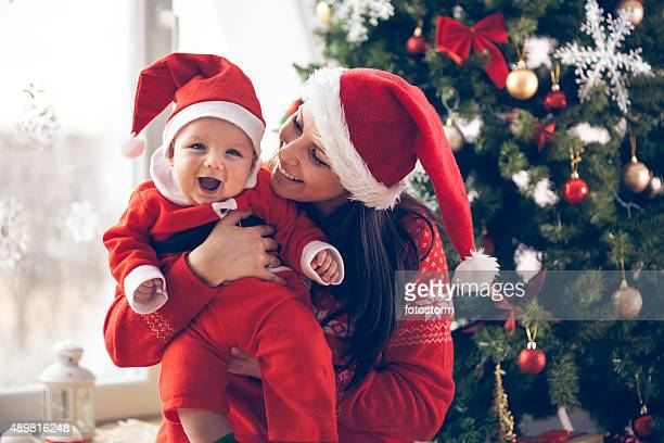 Mother and her baby boy enjoying Christmas