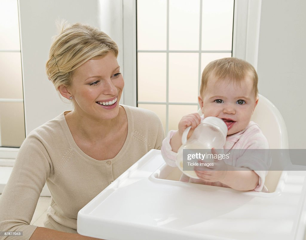 A mother and her baby girl : Stock Photo