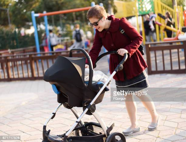 Mother and her baby in a park