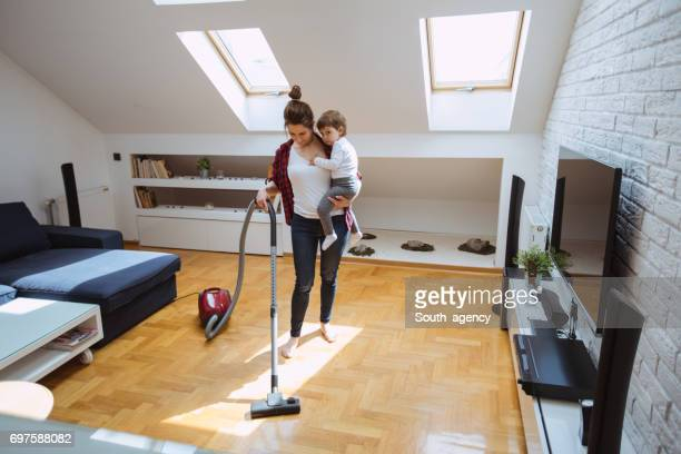 Mother and her child cleaning