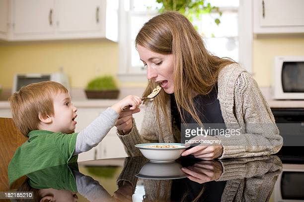 A mother and her child having breakfast together