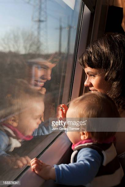 Mother and her child looks out of trains window
